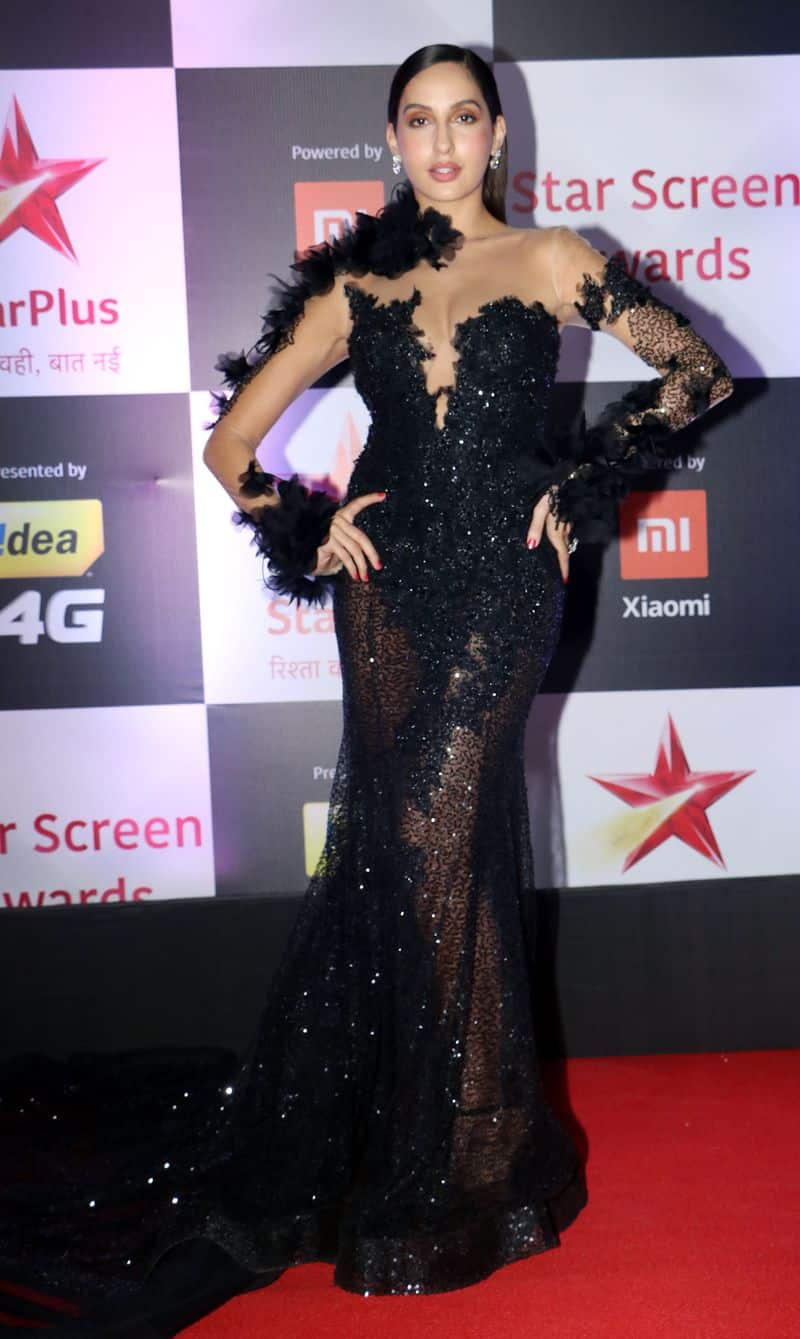 Nora Fatehi dresses in an all-black sheer beauty for the Star Screen Awards.