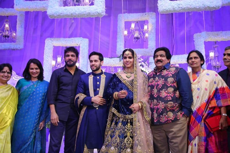 Saina Nehwal and Parupalli Kashyap's wedding reception was a rather grand affair held in Hyderabad with several famous personalities from the world of sports, politics, entertainment and business attending the do. South superstar Nagarjuna and actress Rakul Preet were among the few prominent actors seen at the wedding reception last evening. Check out the pictures.