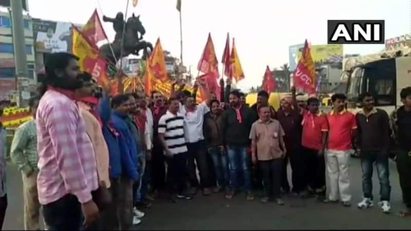 Visuals from Karnataka: People with red flags are seen taking over the roads in support of the 48-hour nationwide strike called by Central Trade Unions.