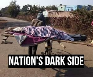 Odisha boy carries dead mother bicycle villagers refuse touch low caste