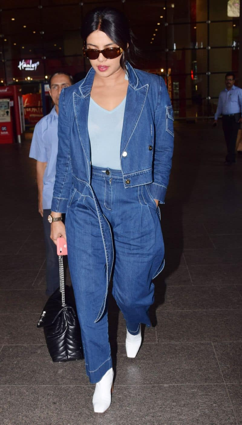 Priyanka Chopra keeps it casual with the timeless denim-on-denim look and glossy, moisturised lips. Hydration is the key for a perfect airport look.