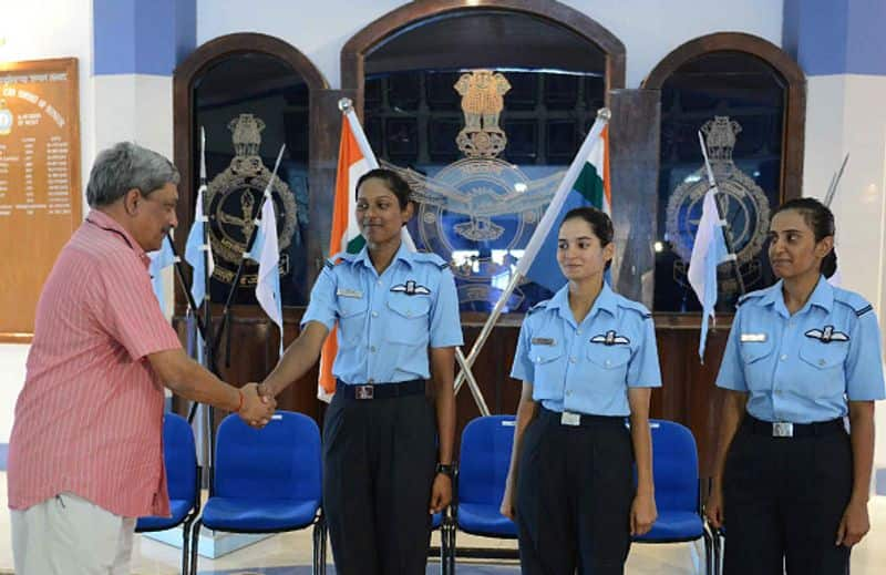 Manohar Parrikar (L) congratulated three of the Indian Air Force's fighter pilots Bhawana Kanth (L), Avani Chaturvedi (C) and Mohana Singh after the combined graduation parade at the air force academy at Dundigal in Hyderabad on June 18, 2016. The first three women fighter pilots of the Indian Air Force had been conferred with the President's commission, and 22 women trainees were commissioned as flying officers from the Air Force Academy.