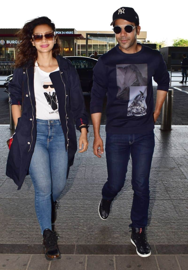Playing casual while jet-setting, couple Patralekha and Rajkummar Rao, colour-coordinated navy outfits.