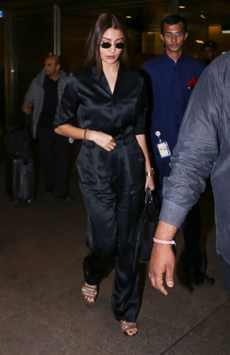 Anushka Sharma was spotted jet setting like a bawse in shiny separates and the very in-vogue tiny sunglasses.