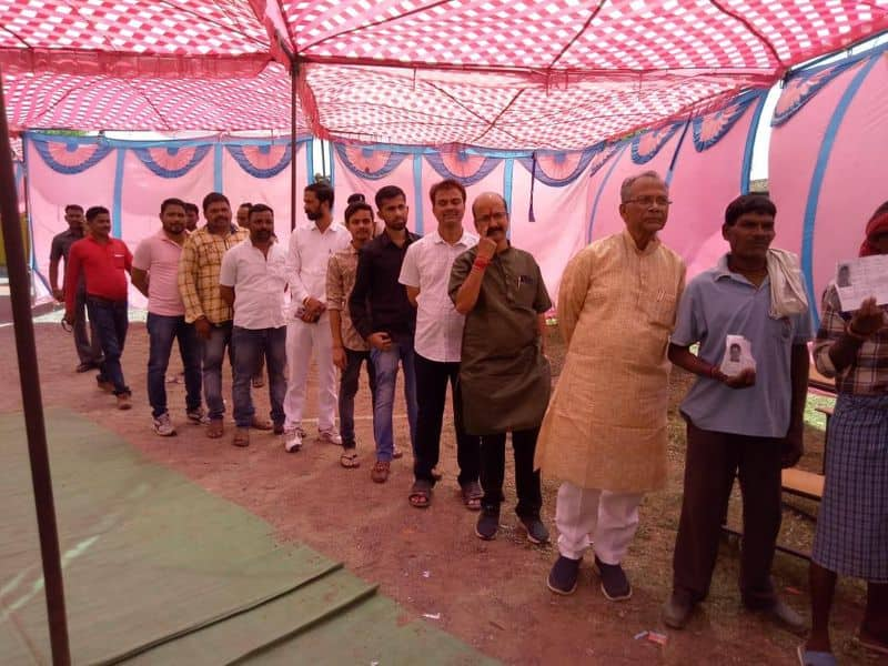 Chhattisgarh home minister Tamradwaj Sahu also stood in line to exercise his franchise at a polling centre in Durg district