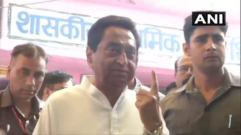 Madhya Pradesh Chief Minister Kamal Nath casts his vote at polling booth number 17 in Shikarpur, Chhindwara.