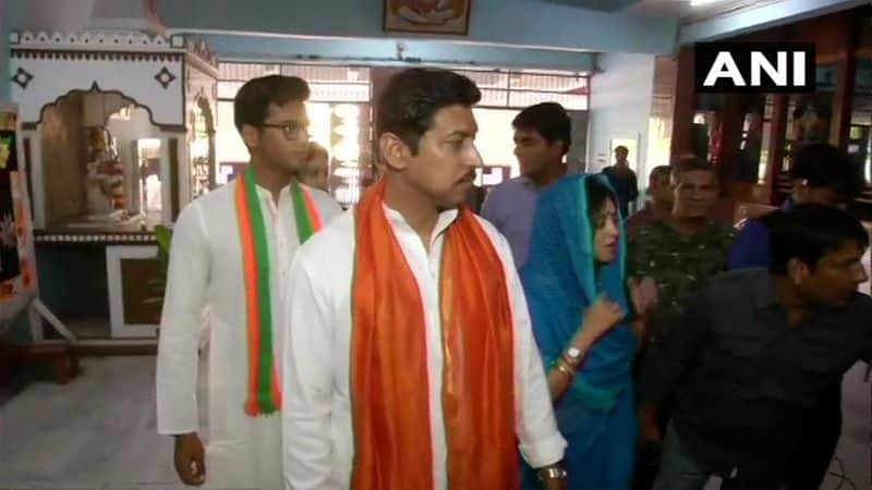 Union Minister Rajyavardhan Singh Rathore and his wife Gayatri Rathore arrive at a polling station in Jaipur to cast their votes.