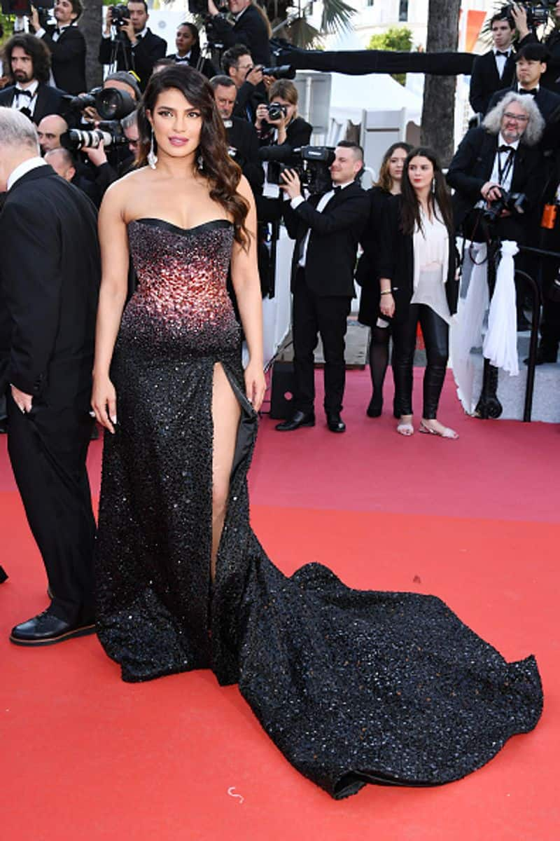 Actress Priyanka Chopra made her debut at Cannes Film Festival on Thursday, greeting the crowd and cameras with a namaste in a glittering strapless gown.