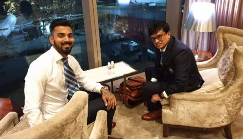 Batsman KL Rahul (left) and trainer Shanker Basu strike a pose before their departure to England.