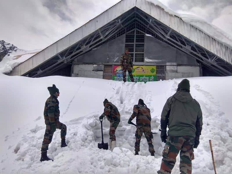 Indian Army teams comprising of Surya Bengal Sappers are braving the harsh weather to clear 6km route, which currently covered in snow.