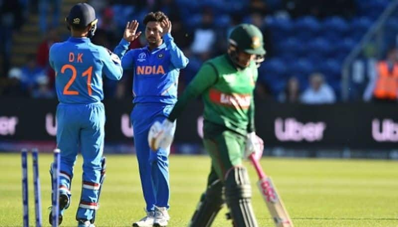 Kuldeep Yadav (centre) celebrates a wicket with Karthik. He accounted for three victims.
