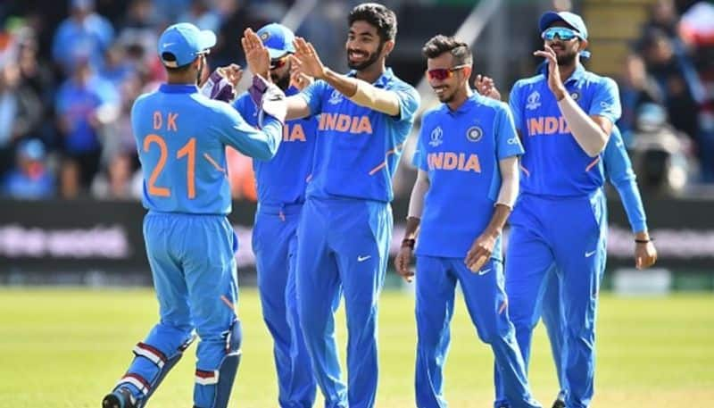 Jasprit Bumrah (centre) celebrates with teammates after taking the wicket of Bangladesh's Shakib Al Hasan for a duck