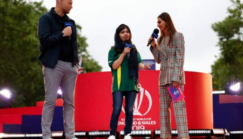 Former England all-rounder Andrew Flintoff (left) talks to Nobel Prize winner Malala Yousafzai with another TV broadcaster