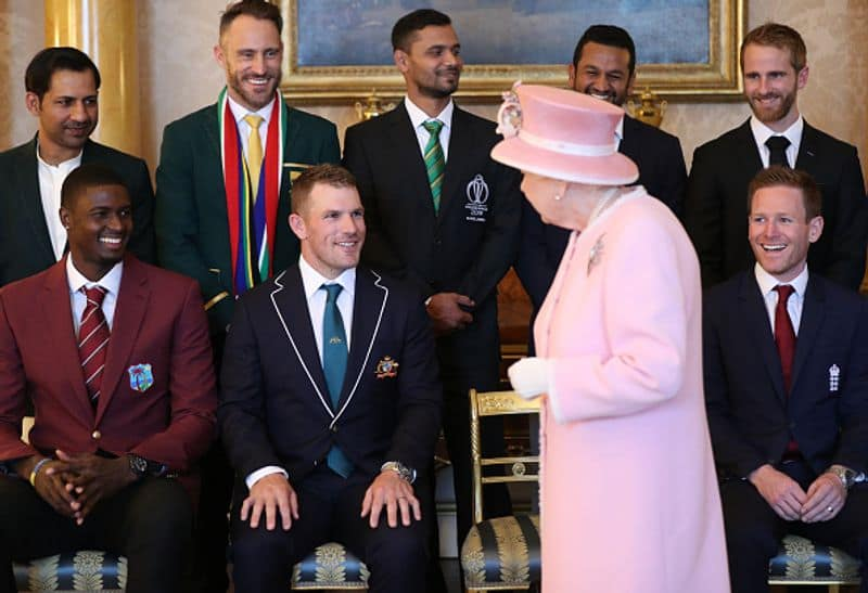 Queen Elizabeth chats with Australian captain Aaron Finch as others look on