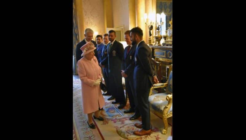 Queen Elizabeth talks to Virat Kohli. This photo was tweeted by the BCCI