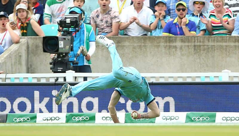Stokes tumbles on to the ground but completes an incredible catch