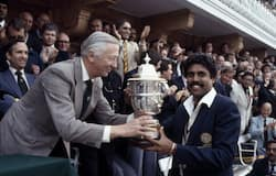 Kapil receives the Prudential World Cup Trophy from the Chairman of Prudential Assurance, Lord Carr of Hadley