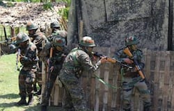 Exchange of firing underway between terrorists and security forces at Chadoora area of Budgam district