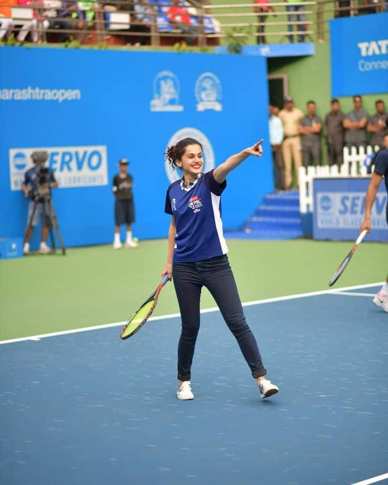 """Tapsee picks a tennis racket at Maharashtra Open tournament: """"Today when I finally picked a tennis racket it was in an ATP @maharashtraopen tournament along with some legendary players. This will be memorable and that's not just coz I looked like the biggest fool on court,"""" Tapsee wrote on her Instagram account."""