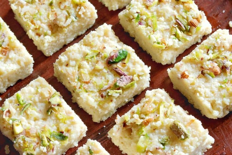 Kalakand is made with full cream milk, sugar and dry fruits.  In this recipe milk heated  and thickened. Then sugar and dry fruits are added to it. Later it will be cut into small square pieces.
