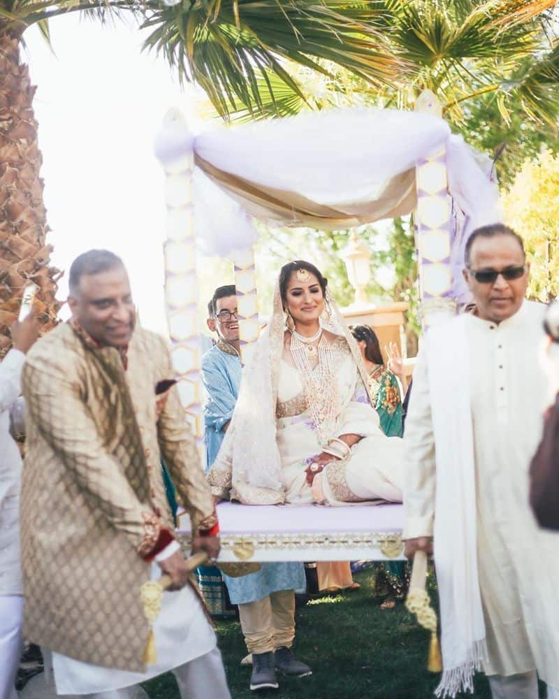 Bilal Hussain Kazimov, South Asian fashion designer dressed Maieli up in a stunning ivory sari, complete with a maang tikka (head jewellery), gold bangles and pearl kadas (bangles).