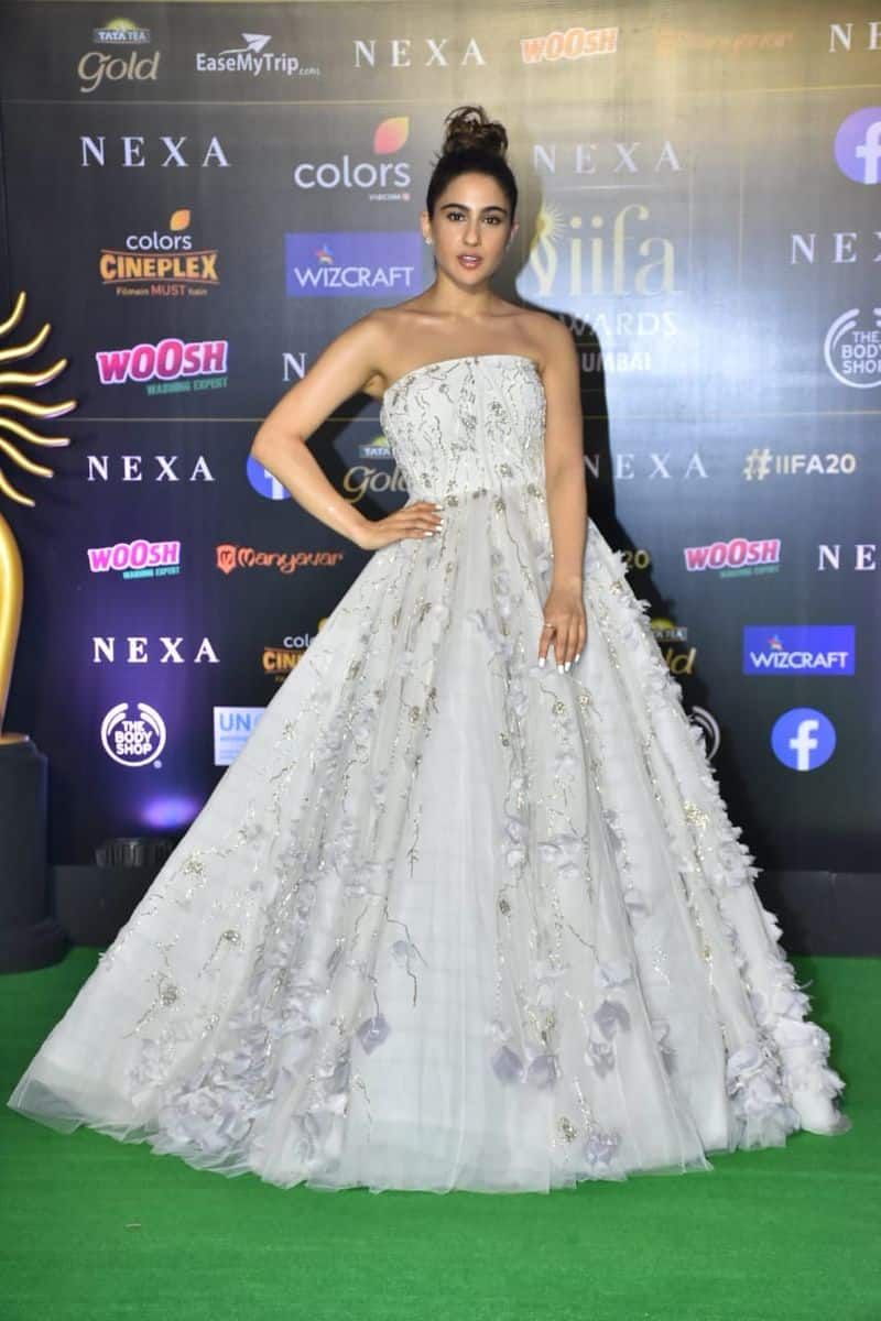 """Sara, who was one of the first celebrities to arrive, turned heads in a stunning white princess gown. The official Instagram account of IIFA posted the picture, writing, """"Our princess @saraalikhan95 beating Cinderalla at her own game."""""""