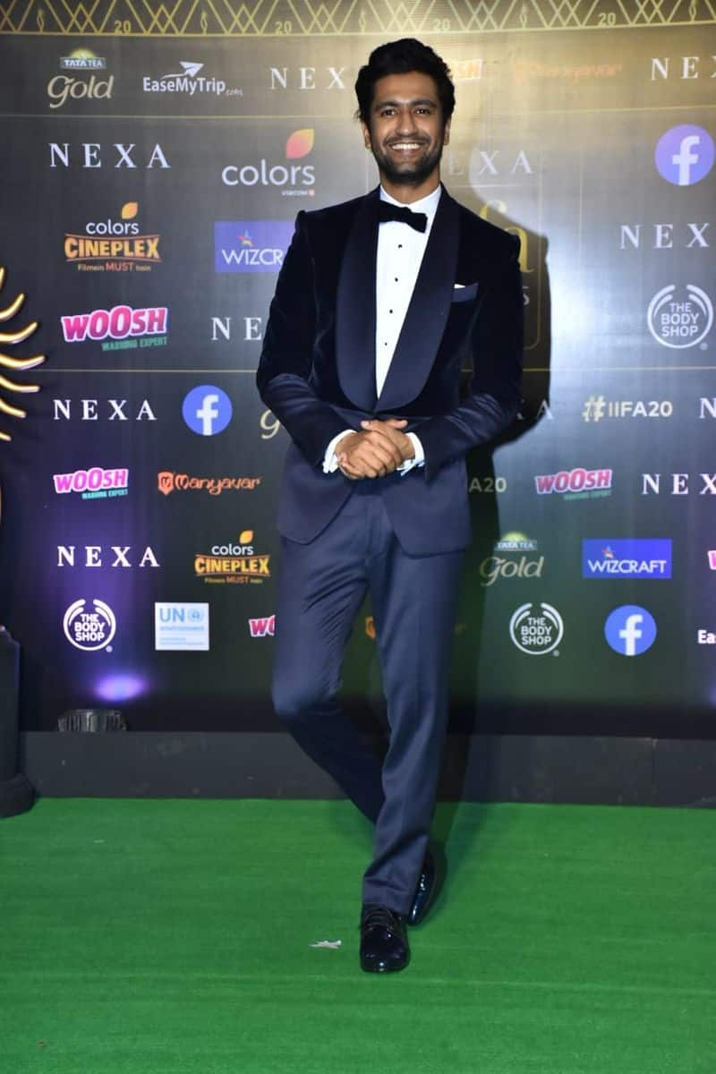 Vicky Kaushal walked the green carpet looking dapper in a white shirt, black blazer and matching pants coupled with formal shoes to finish off his look.