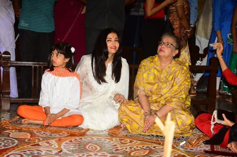 Aishwarya opted for a white salwar kameez and cutie Aaradhya was dressed in white and orange churidar kurta