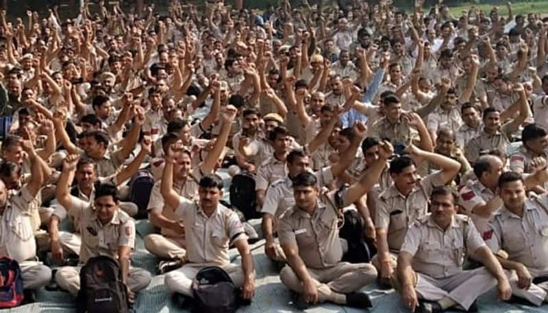 Thousands of police personnel protest outside the Police Headquarter in Delhi