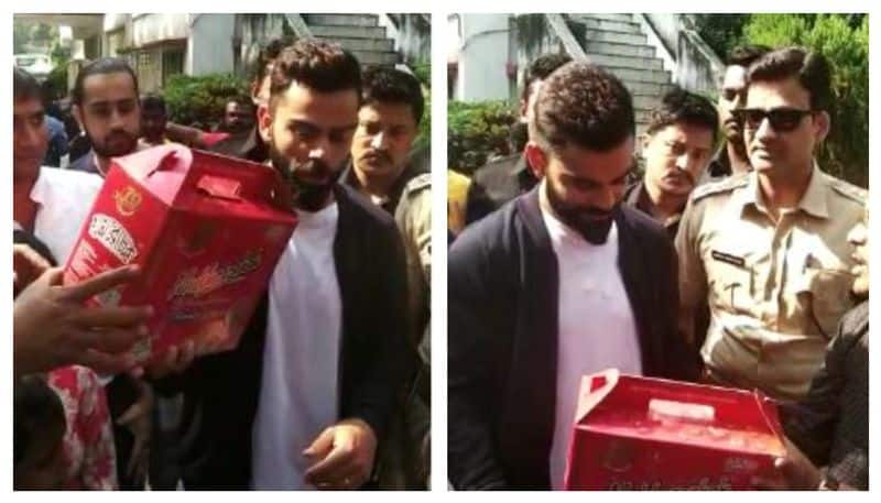 Children suffering from HIV gifted a boquet made of 254 roses to Virat Kohli