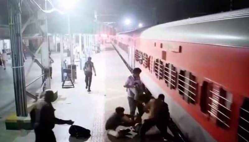 Passenger slipped after trying to get in running train