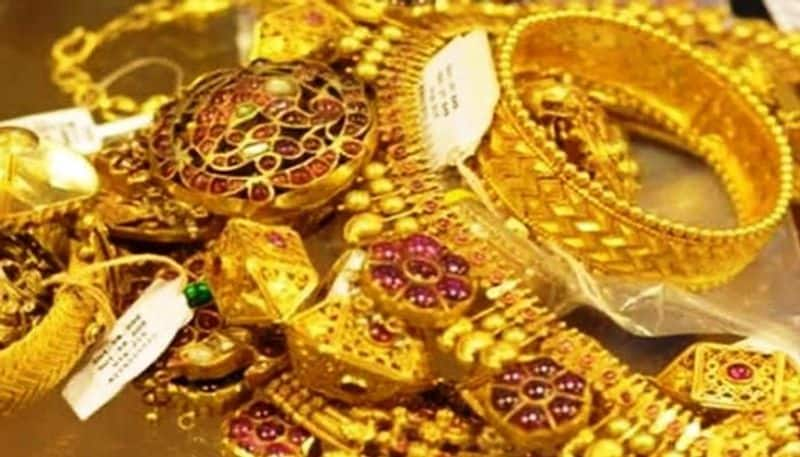 Gold prices down after record high