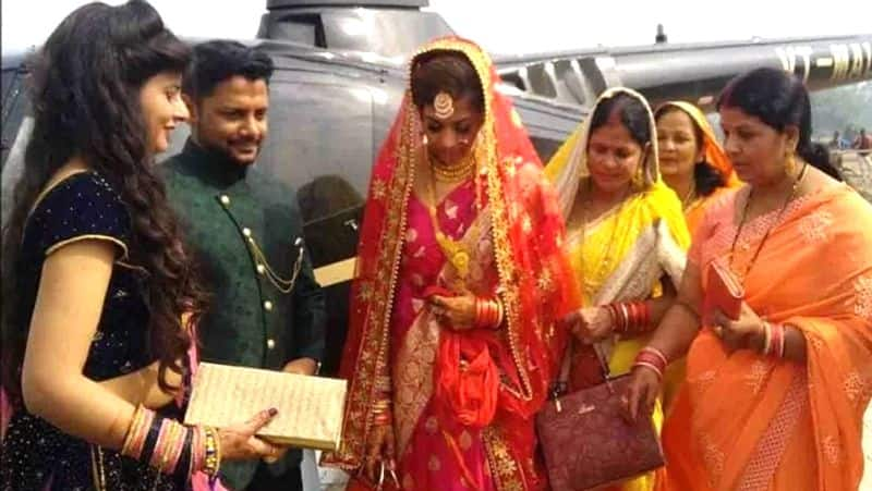 bride groom arrives in village from helicopter