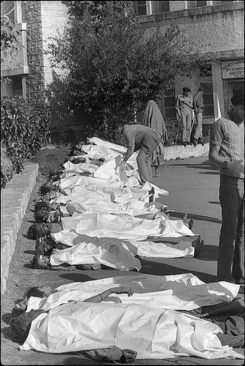 The tragedy also known as Bhopal disaster killed more than 3,500 people on the spot. At least 5,00,000 were affected by methyl isocyanate (MIC) gas. Bodies of victims of Bhopal gas tragedy lie on a roadside on December 4, 1984 in Bhopal. Warren Anderson, the former CEO of Union Carbide Corp, died at 92 in 2014.
