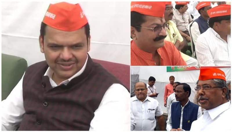 Fadnavis, other BJP MLAs enter Maha Assembly with 'I am Savarkar' caps, protest Rahul Gandhi's remark