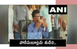 YSR Congress party MP Gorantla Madhav kisses the shoe of a  policeman