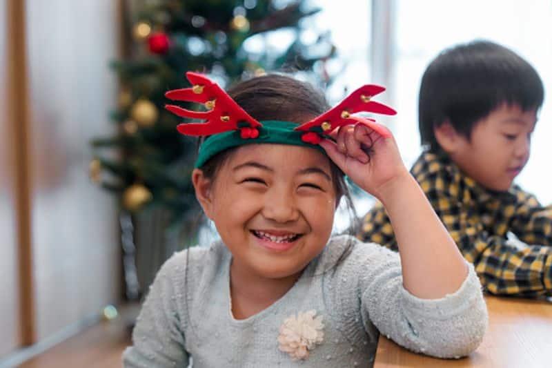 Young girls love Christmas reindeer antlers