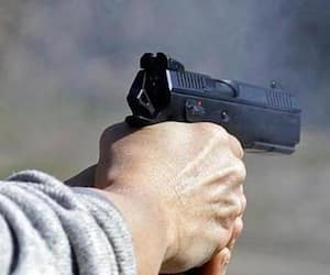 62 year old woman shot dead by neighbour over property dispute in up kpt