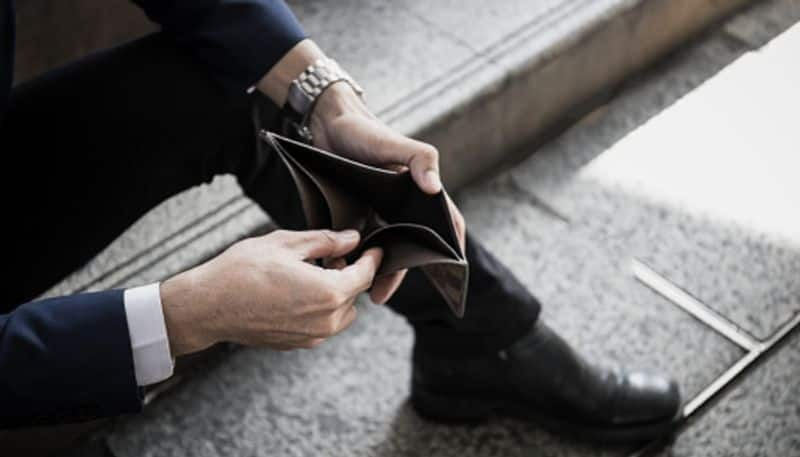 When is the worst financial crisis in life according to astrology
