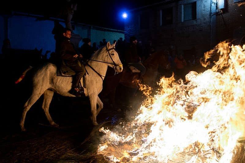 Horses leap through flames in Spain