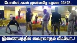 a boy dance in front of the police