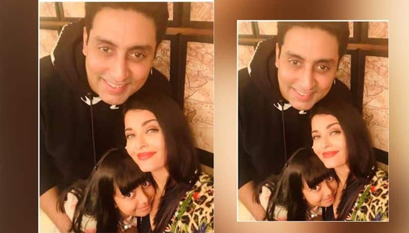 The second picture has Aishwarya, Abhishek and Aaradhya, smiling ear to ear.
