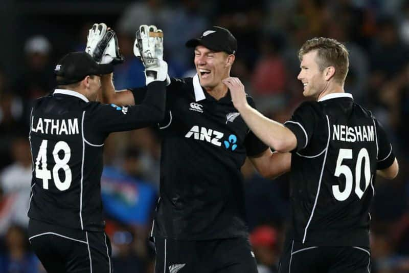 Tom Latham, Kyle Jamieson and Jimmy Neesham of the Black Caps celebrate after winning game two of the One Day International Series between New Zealand and India at at Eden Park on February 08, 2020 in Auckland, New Zealand.