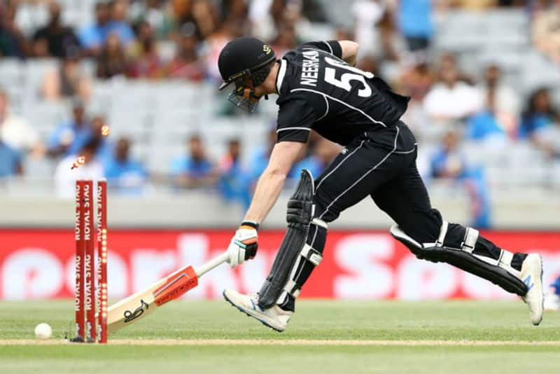 Jimmy Neesham of the Black Caps is run out by Ravindra Jadeja of India during game two of the One Day International Series between New Zealand and India at at Eden Park on February 08, 2020 in Auckland, New Zealand.