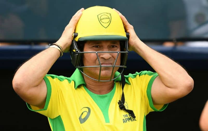 """Sachin Tendulkar prepares to bat during the Bushfire Cricket Bash T20 match between the Ponting XI and the Gilchrist XI at Junction Oval on February 09, 2020 in Melbourne, Australia. Tendulkar, was quick to respond to Ellyse Perry's challenge, saying, """"Sounds great Ellyse,""""."""