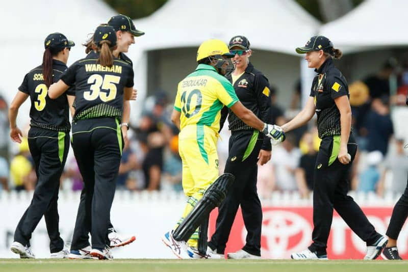 Sachin Tendulkar shakes hands with Jess Jonassen of Australia during the Bushfire Cricket Bash T20 match between the Ponting XI and the Gilchrist XI at Junction Oval on February 09, 2020 in Melbourne, Australia.