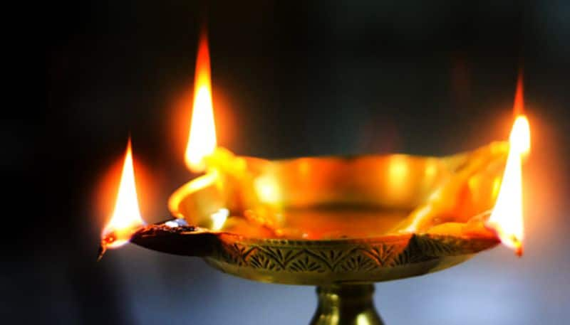 Modis light a diya event In spite of critics pooh-poohing  the idea, its time to light lamp of knowledge