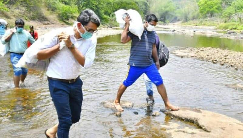 mla and collector trek 3 kilometers to reach tribal families with food and essentials in kerala