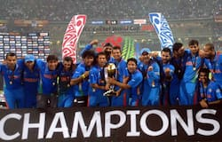 Indian players pose with the World Cup trophy.
