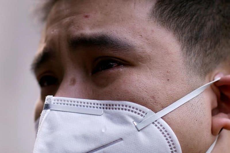 China again reports coronavirus, nearly 100 cases in single day